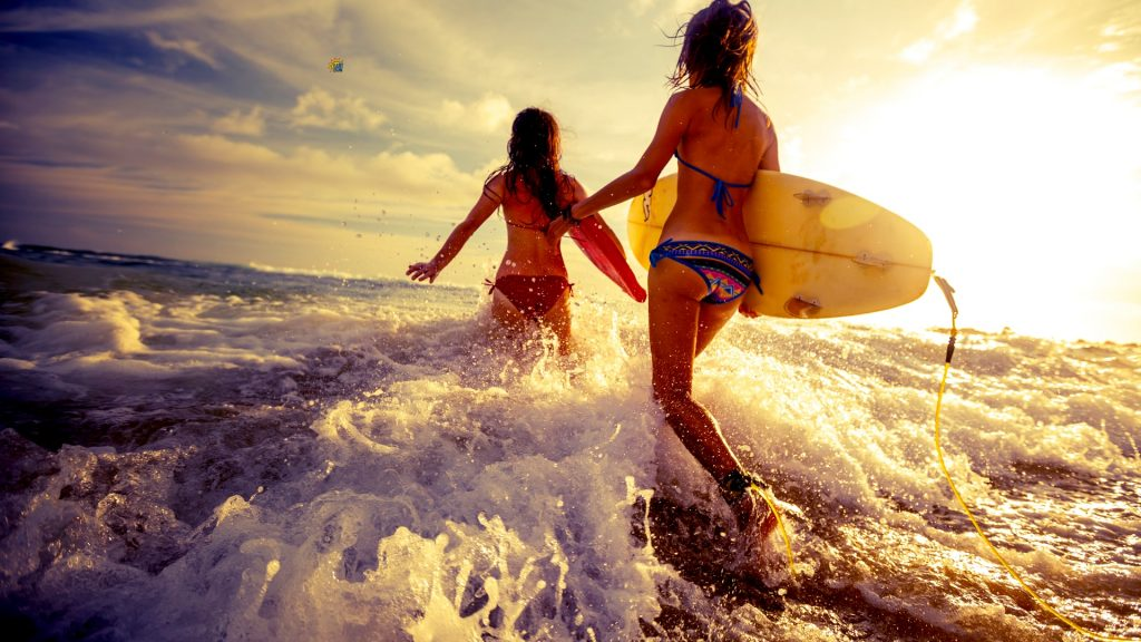 Girls wearing sunscreen going surfing